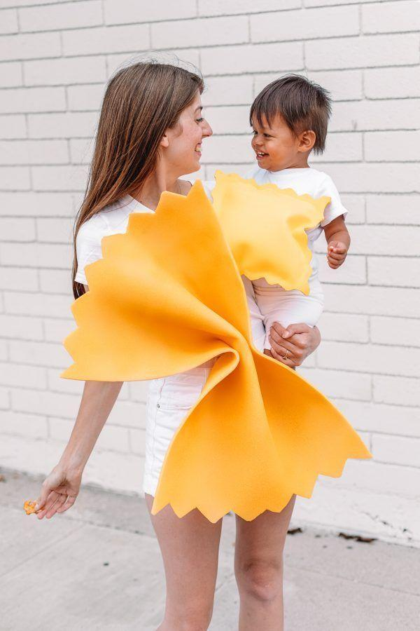 """<p>Celebrate Halloween with this mommy-and-me <a href=""""https://studiodiy.com/diy-pasta-costume/"""" rel=""""nofollow noopener"""" target=""""_blank"""" data-ylk=""""slk:DIY pasta costume"""" class=""""link rapid-noclick-resp"""">DIY pasta costume</a>. You'll flip for this farfalle and ravioli look. Your little meatball will love it too.<br></p>"""