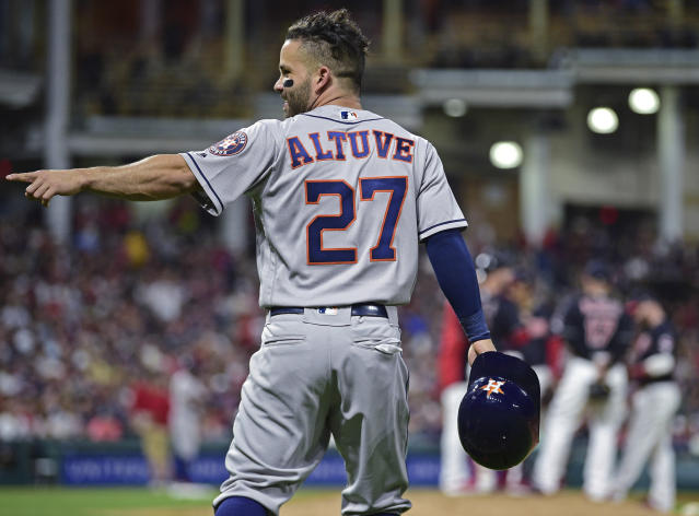 Houston Astros' Jose Altuve celebrates after hitting a two-run double off Cleveland Indians relief pitcher Andrew Miller during the eighth inning of a baseball game Friday, May 25, 2018, in Cleveland. (AP Photo/David Dermer)