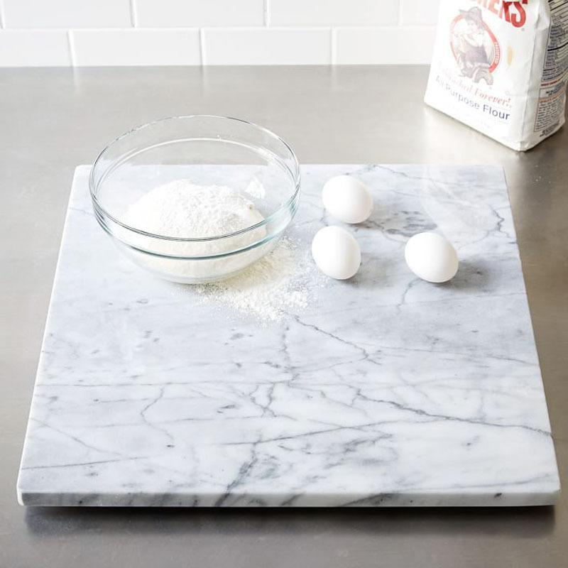 """<p>Give the gift of easier baking with this marble pastry stone. It stays cooler than other surfaces, so even the most delicate dough rolls out with ease. Bonus: The sophisticated stone also makes a great cheese board, and it looks gorgeous on Instagram. <b>Price: $79. <a href=""""http://www.westelm.com/products/mrk-marble-pastry-slab-d2440/?pkey=e%7Cmarble%7C53%7Cbest%7C0%7Cviewall%7C24%7C%7C36&cm_src=PRODUCTSEARCH"""" rel=""""nofollow noopener"""" target=""""_blank"""" data-ylk=""""slk:Find the pastry slab at West Elm."""" class=""""link rapid-noclick-resp"""">Find the pastry slab at West Elm.</a> </b><i>(Photo: West Elm)</i></p>"""