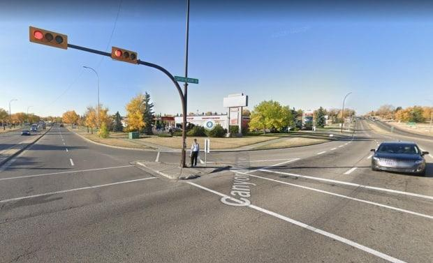 A woman in her 20s was struck when a 2009 Hyundai Accent travelling northbound on Deer Ridge Drive S.E. began to turn westbound onto Canyon Meadows Drive, police said. (Google Earth - image credit)