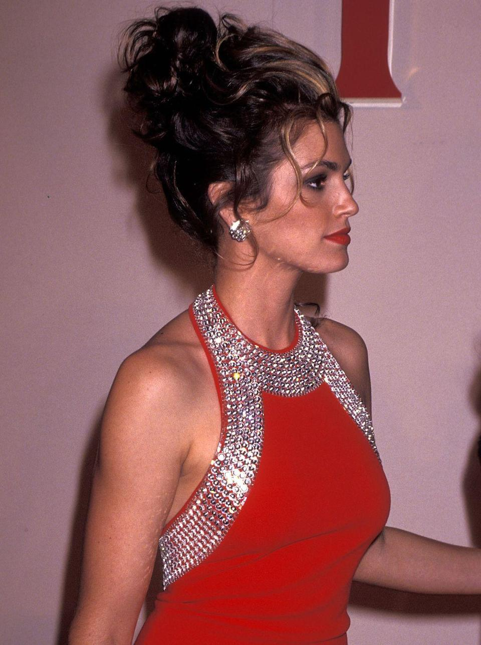 <p>Glam supermodels, including Cindy Crawford, popularized over-the-top updos with face-framing pieces.</p>