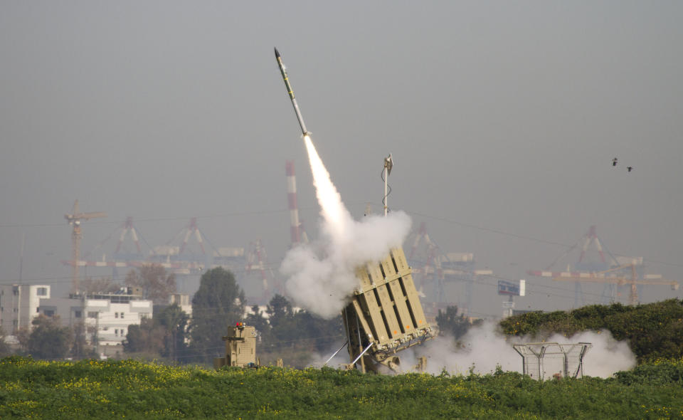 """<p> FILE - In this Sunday, March 11, 2012 file photo, a rocket is launched from the Israeli anti-missile system known as """"Iron Dome"""" in order to intercept a rocket fired by Palestinian militants from the Gaza Strip in Ashdod, Israel. Last year Israel activated the Iron Dome, a first-of-its-kind system that intercepts rockets fired from short distances of up to 70 kilometers (50 miles) and has shot down dozens of rockets launched from the Gaza Strip, including several projectiles fired over the past week. (AP Photo/Ariel Schalit, file) </p>"""