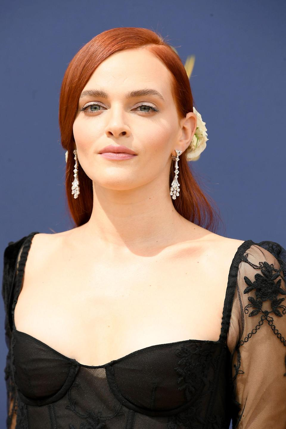 <p>Madeline Brewer accessorized her half-updo with an elegant flower clip, created with real roses by hairstylist Mara Roszak.</p>