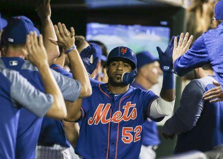FILE PHOTO: May 4, 2018; New York City, NY, USA; New York Mets left fielder Yoenis Cespedes is congratulated in the dugout after scoring in the eighth inning against the Colorado Rockies at Citi Field. Mandatory Credit: Wendell Cruz-USA TODAY Sports