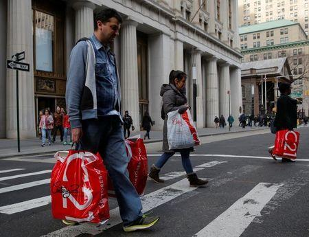 People cross Broadway with shopping bags in Manhattan, New York City