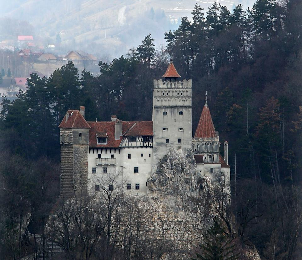 """BRAN, ROMANIA - MARCH 10:  Bran Castle, famous as """"Dracula's Castle,"""" stands among Transylvanian mountains on March 10, 2013 in Bran, Romania. Bran Castle's reputation as the supposed home to Dracula corresponds little with Bram Stoker's novel, nor did Vlad Tepes, the sadistic 15th-century Wallachian prince, ever live there. Nevetheless the castle retains the myth and tourists flock there in large numbers. Bran Castle, along with the mountainous region of southern Transylvania, which is home to Saxon fortified towns and churches, are among the asssets the Romanian government hopes will bring increasing numbers of tourists to the country. Both Romania and Bulgaria have been members of the European Union since 2007 and restrictions on their citizens' right to work within the EU are scheduled to end by the end of this year. However Germany's interior minister announced recently that he would veto the two countries' entry into the Schengen Agreement, which would not affect labour rights but would prevent passport-free travel.  (Photo by Sean Gallup/Getty Images) (Photo: Sean Gallup via Getty Images)"""