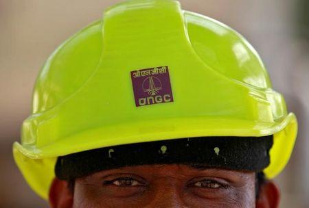 FILE PHOTO: A technician is pictured inside a desalter plant of Oil and Natural Gas Corp (ONGC) on the outskirts of Ahmedabad