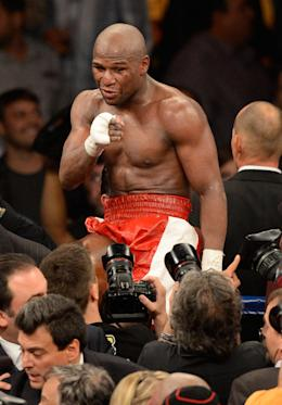 Floyd Mayweather Jr. celebrates after winning a fight. (Getty)
