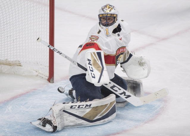 Florida Panthers goaltender Roberto Luongo (1) makes a save against the Montreal Canadiens during third-period NHL hockey game action in Montreal, Monday, March 19, 2018. (Graham Hughes/The Canadian Press via AP)