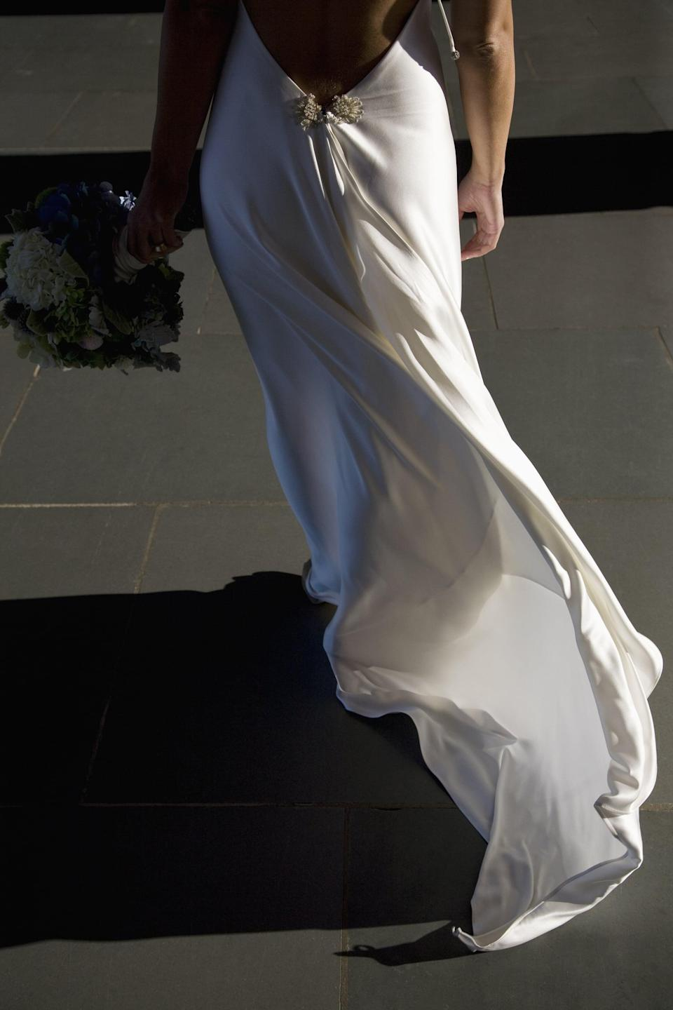 <p>If you're besotted with your dress, let it have its own big moment. A classic shot from the waist down means viewers are forced to take in the gown in all its glory.</p>