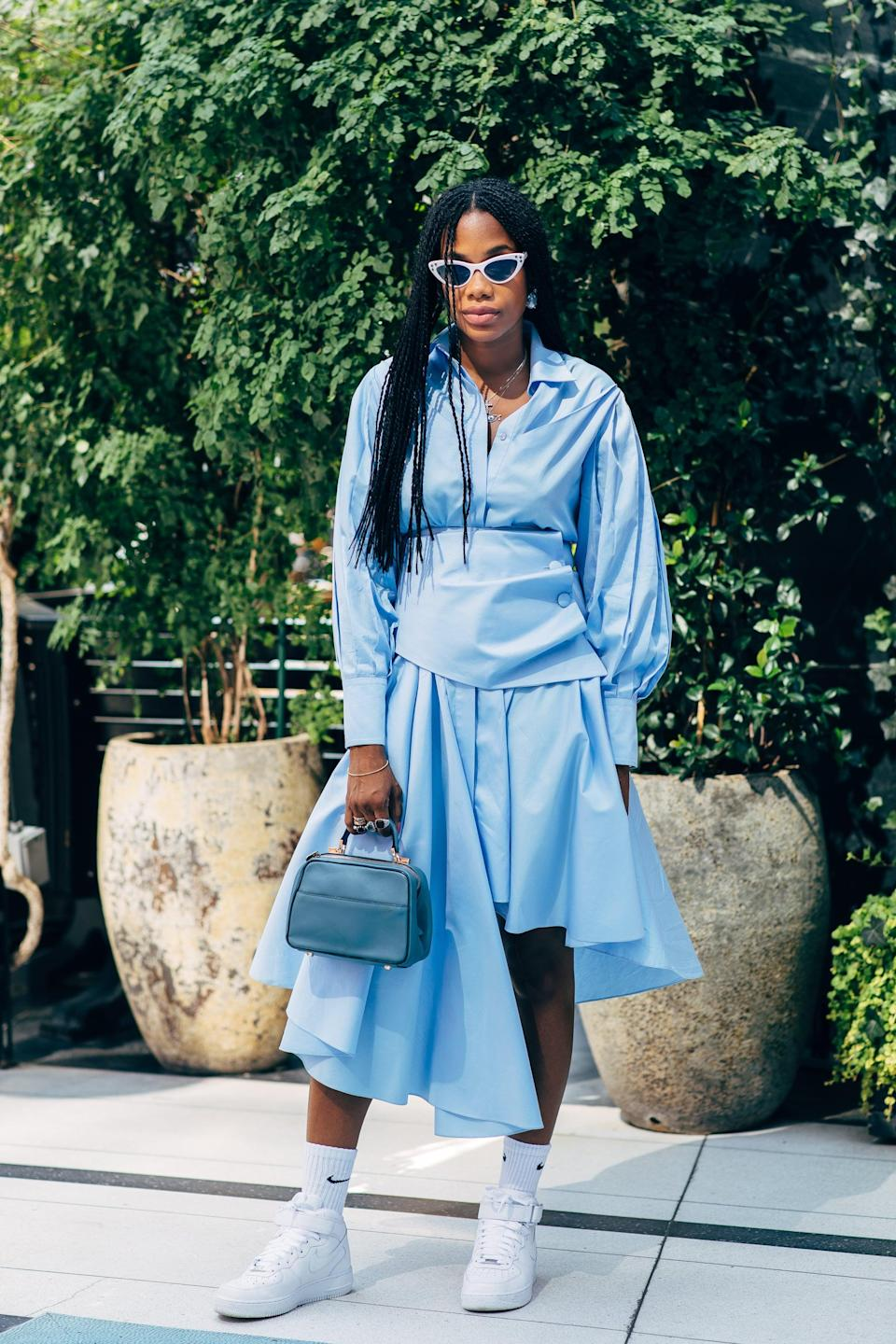<p>We love the look of a tailored shirt dress and sneakers.</p>