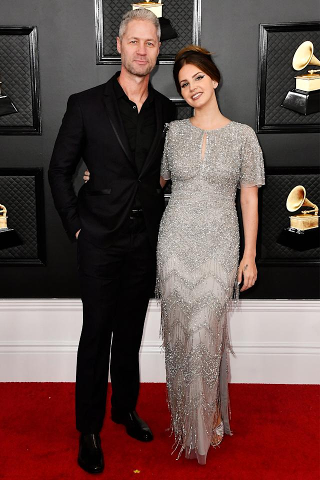 """<p>The singer and her police officer boyfriend <a href=""""https://people.com/music/lana-del-rey-sean-larkin-split/"""">called it quits recently</a>, Larkin recently confirmed.</p> <p>The duo were first spotted together in September and made a very public appearance at the Grammys in January, but by March Larkin told the <em>New York Times </em>they were now """"just friends. We still talk and whatnot, we just have busy schedules right now.""""</p>"""