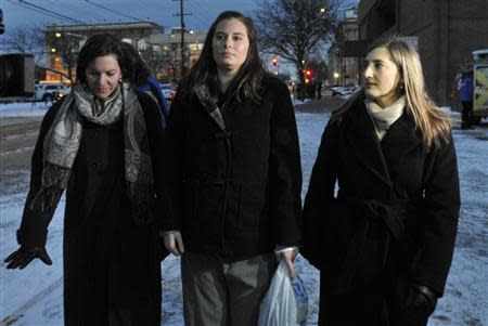 Jordan Graham accompanied by members of her legal team, walks away from U.S. District Court in Missoula