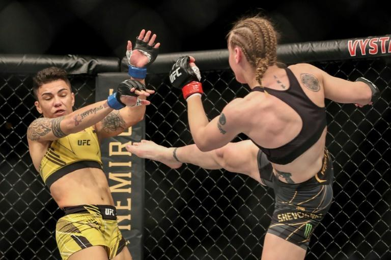 The first of the three title fights on the card saw Shevchenko of Kyrgyzstan use her superior strength and a nine centimeter height advantage to overpower Brazilian challenger Jessica Andrade