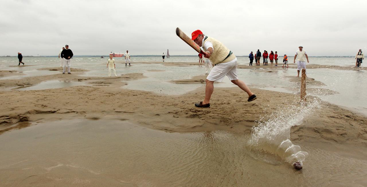 SOUTHAMPTON, ENGLAND - AUGUST 14:  Teams play a cricket match in the middle of The Solent on the Brambles sandbank which appears for 30 minutes at low tide on August 14, 2010 in Southampton, England. The annual cricket match takes place between the Royal Southern Yacht Club, based in Hamble, and Cowes's Island Sailing Club. Boats of players and spectators travel from the Isle of White and Southampton to wait around Bramble Bank to appear at low tide play continues until the tide returns.  (Photo by Oli Scarff/Getty Images)