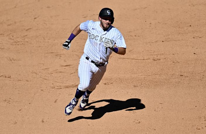 Sep 2, 2020; Denver, Colorado, USA; Colorado Rockies second baseman Garrett Hampson (1) heads home to score a run in the sixth inning against the San Francisco Giants at Coors Field. Mandatory Credit: Ron Chenoy-USA TODAY Sports