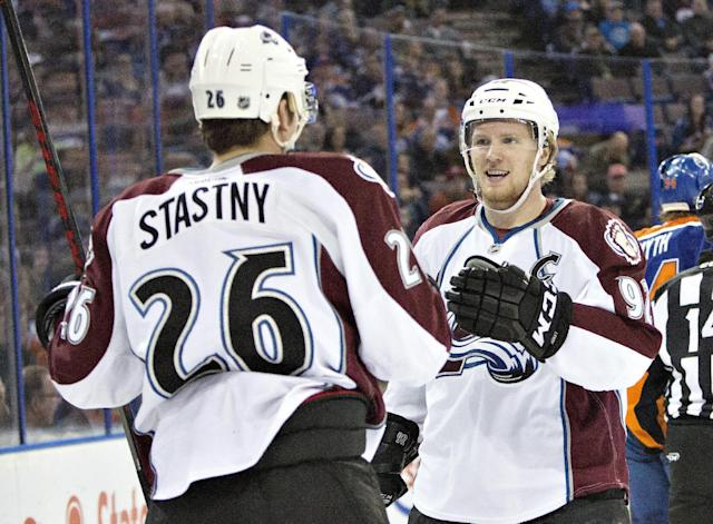 Colorado Avalanche's Paul Stastny (26) and Gabriel Landeskog (92) celebrate a goal against the Edmonton Oilers during first period NHL hockey action in Edmonton, Alberta, on Tuesday April 8, 2014. (AP Photo/The Canadian Press, Jason Franson)