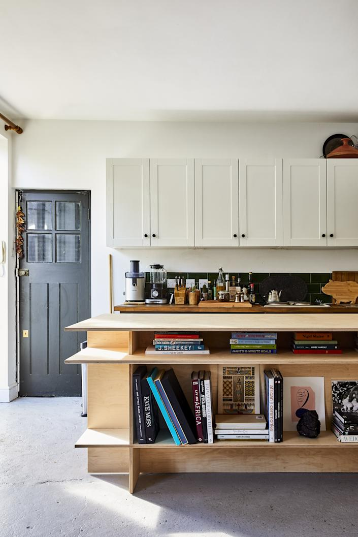 The kitchen island was custom-designed to include ample space for storage.