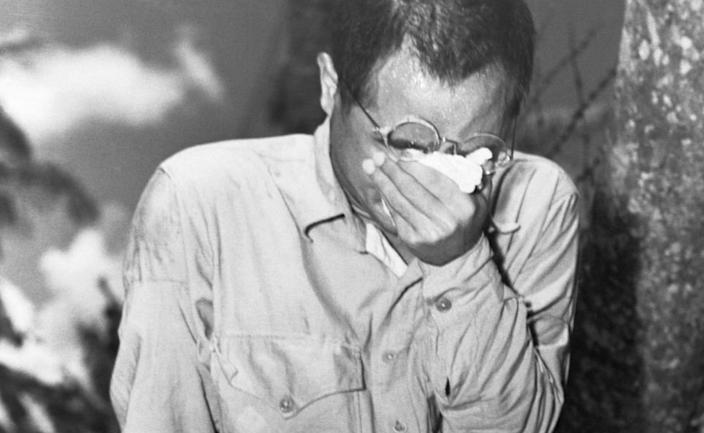 A Japanese prisoner of war reacts after hearing Emperor Hirohito's surrender