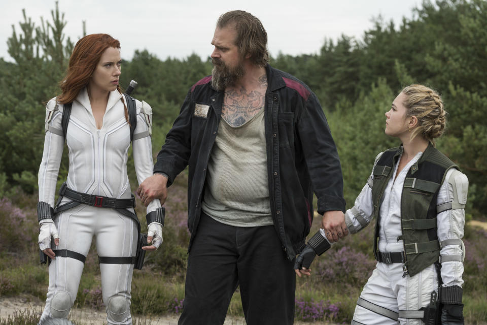 (L-R): Black Widow/Natasha Romanoff (Scarlett Johansson), Alexei (David Harbour) and Yelena (Florence Pugh) in Marvel Studios' BLACK WIDOW, in theaters and on Disney+ with Premier Access. Photo by Jay Maidment. ©Marvel Studios 2021. All Rights Reserved.