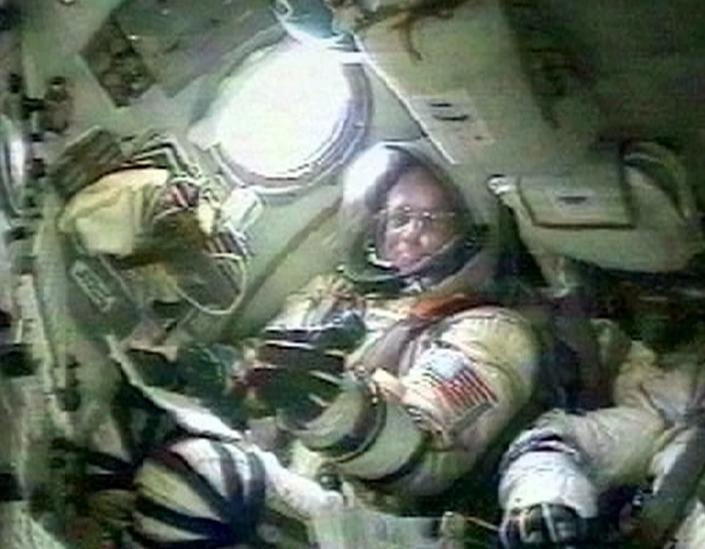 FILE - In this Saturday, April 28, 2001 image from video made available by the Russian Space Agency, U.S. space tourist, California millionaire Dennis Tito sits inside the cockpit of the Soyuz spaceship, at the Baikonur cosmodrome in Kazakstan, before he and Russian cosmonauts Talgat Musabayev and Yuri Baturin travel to the International Space Station. (Russian Space Agency via AP)