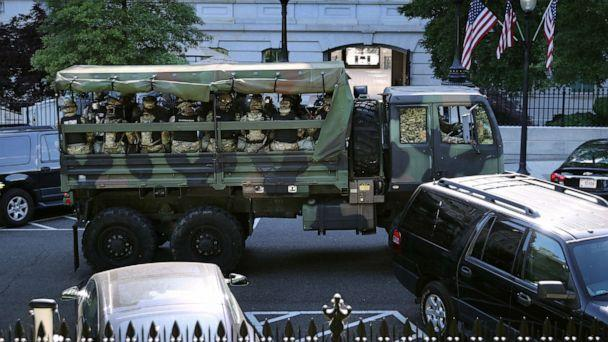 PHOTO: Trucks transport District of Columbia National Guard troops along West Executive Drive in support of law enforcement officers that are keeping demonstrators away from the White House, June 01, 2020, in Washington. (Chip Somodevilla/Getty Images)