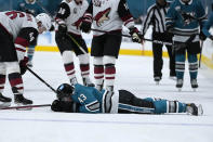 San Jose Sharks left wing John Leonard (43) lies on the ice after colliding with the boards during the first period against the Arizona Coyotes in an NHL hockey game Friday, May 7, 2021, in San Jose, Calif. (AP Photo/Tony Avelar)
