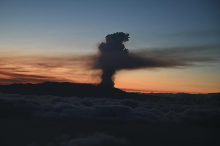 In this photo provided by the Spanish government and taken from a plane carrying Spain's Prime Minister Pedro Sanchez, a volcano erupts on the island of La Palma in the Canaries, Spain, Sunday Sept. 19, 2021. Lava continues to flow slowly from a volcano that erupted in Spain's Canary Islands off northwest Africa. The head of the islands' regional government said Monday he expects no injuries to people in the area after some 5,000 were evacuated.(Borja Puig de la Bellacasa/Spanish Government via AP)