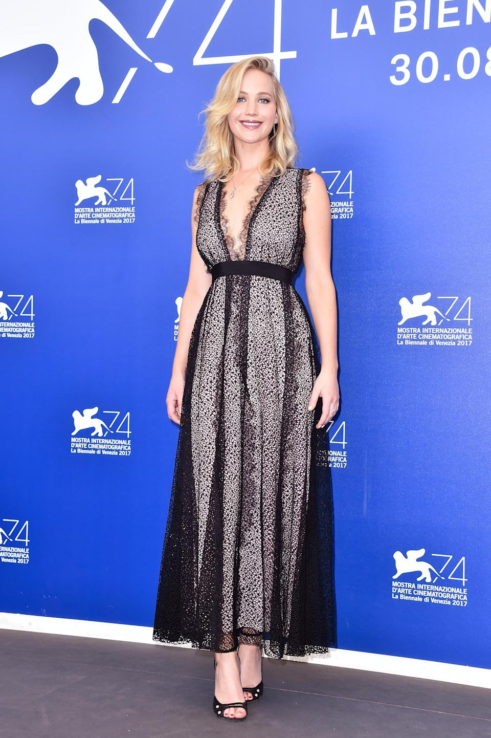 <p>Giambattista Valli provided the perfect dress to kickstart the 'Mother!' tour. The plunging style combined lots of lace and was accessoried with a simple pair of black heels.<br><i>[Photo: Getty]</i> </p>