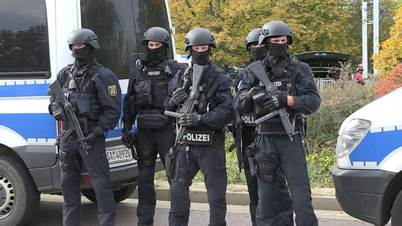 German police arrest 12, including one officer, in probe into far-right group