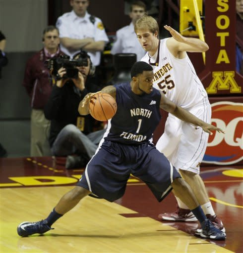 North Florida forward Travis Wallace (1) tries to drive inside against Minnesota center Elliott Eliason (55) during the first half of an NCAA basketball game, Saturday, Dec. 1, 2012, in Minneapolis. (AP Photo/Paul Battaglia)