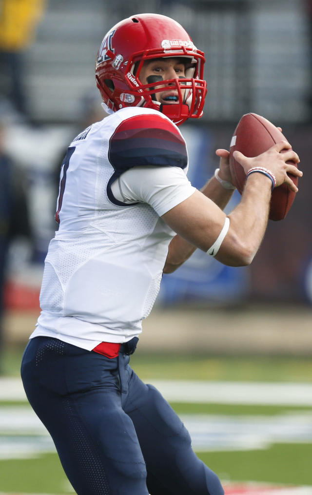 Arizona quarterback B.J. Denker looks for a receiver during the second half of the AdvoCare V100 Bowl NCAA college football game against Boston College, Tuesday, Dec. 31, 2013, at Independence Stadium in Shreveport, La. Arizona won 42-19. (AP Photo/Rogelio V. Solis)