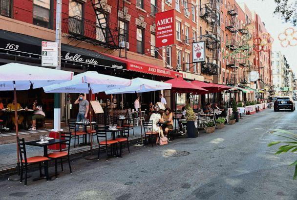 PHOTO: Tables for outdoor dining are set up outside a restaurant in the Little Italy neighborhood on June 24, 2020 in New York City. (Angela Weiss/AFP via Getty Images)