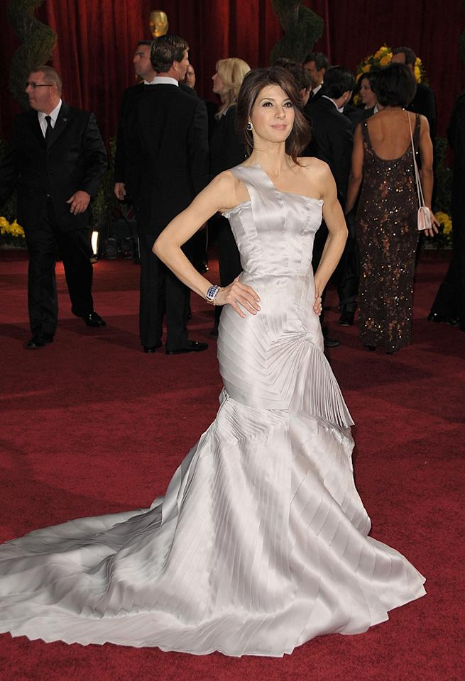 Marisa Tomei   Grade: A-       On the other hand, Mickey's co-star stole the spotlight in a pearl-grey Versace Atelier satin organza gown and Van Cleef & Arpels jewelry.