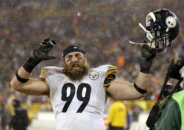 Pittsburgh Steelers' Brett Keisel celebrates after an NFL football game against the Green Bay Packers Sunday, Dec. 22, 2013, in Green Bay, Wis. The Steelers won 38-31. (AP Photo/Jeffrey Phelps)