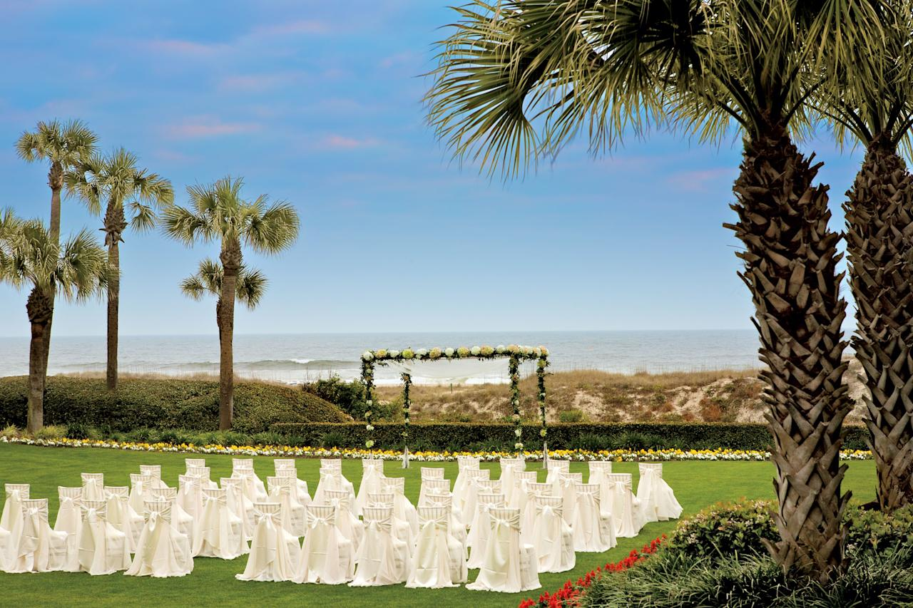 """<p>Tucked away just south of the Florida-Georgia state line is a magnificent venue that marries Florida's easygoing vibe with the South's warm charm. The <a href=""""http://www.ritzcarlton.com/en/hotels/florida/amelia-island"""" target=""""_blank"""">Ritz-Carlton, Amelia Island</a> provides multiple venues within one property—the Atlantic-facing beach, a regal courtyard, and a sprawling oceanfront lawn—that sets the scene for an unforgettable event. A grand ballroom, smaller dining rooms, and terraces are also available for ceremonies, receptions, and other events.</p>"""