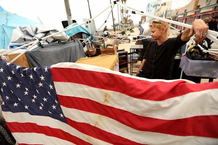 Dixie Moore, 47, who is homeless, assess her situation before trying to move her encampment in Venice