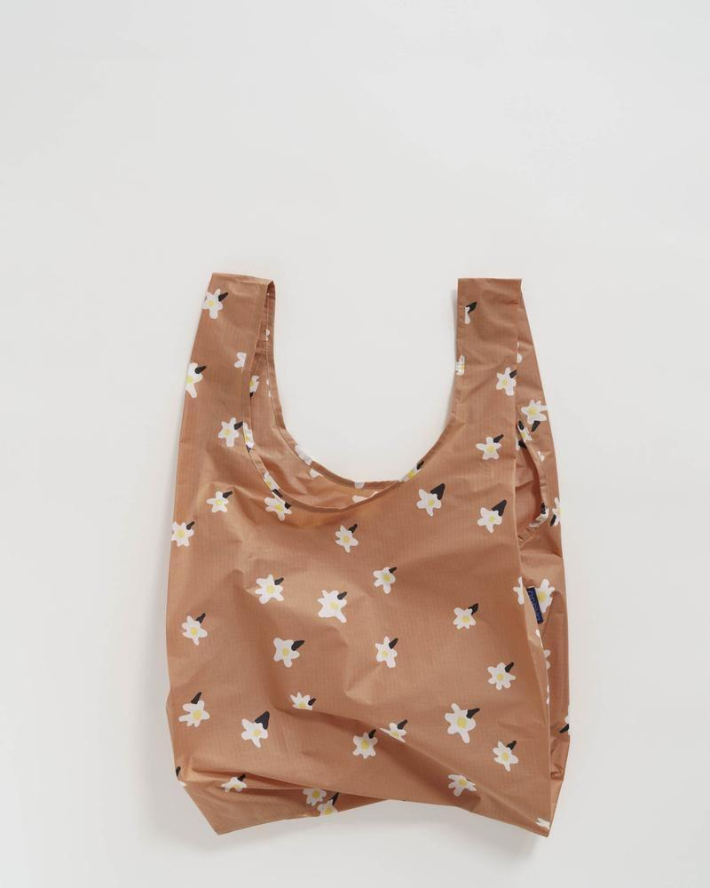 <p>Looking for a bag that can carry just about everything? Then turn your attention to Baggu. These adorable bags are made from sustainable materials and construction methods. The brand's canvas bags are made from 65 percent recycled cotton and cotton scraps recovered from t-shirts and socks that would otherwise go into a landfill. </p> <p><strong>What We'd Buy</strong>: <span>Standard Baggu Painted Daisy</span> ($12)</p>