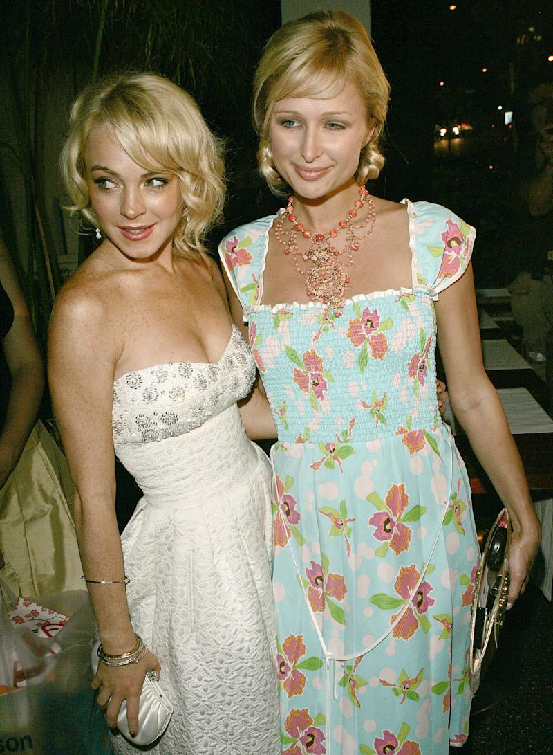 Lindsay Lohan and Paris Hilton in a palsy-walsy moment back in the day. (J. Merritt via Getty Images)