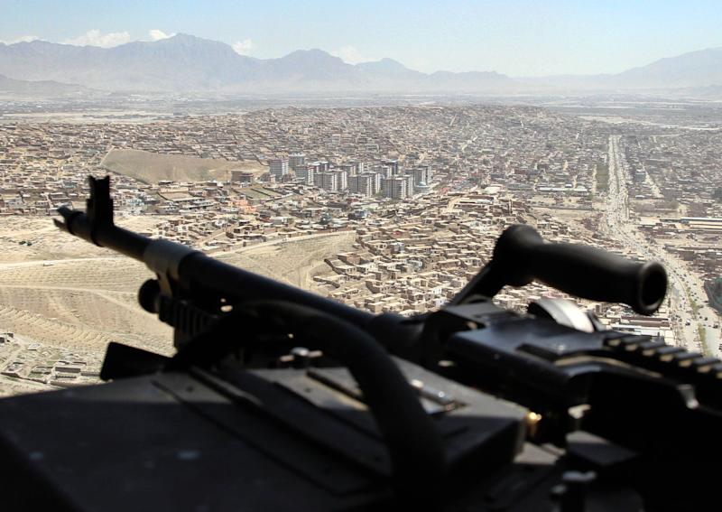 A U.S. Chinook helicopter flies over Kabul, Afghanistan, during a visit of NATO Secretary-General Anders Fogh Rasmussen, Thursday, April 12, 2012. NATO said Thursday it is on track to fully hand over responsibility for securing Afghanistan to local forces by the end of 2014 as scheduled. (AP Photo/Musadeq Sadeq)