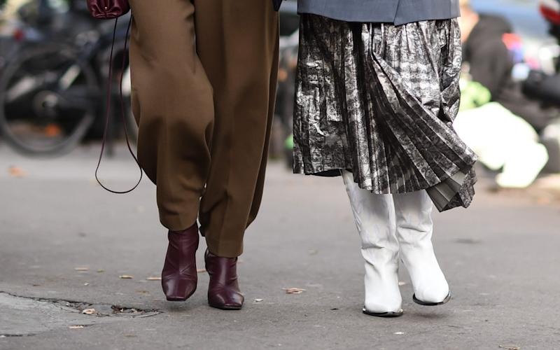 Knee-high and white styles are both trending this winter. - Getty Images Europe