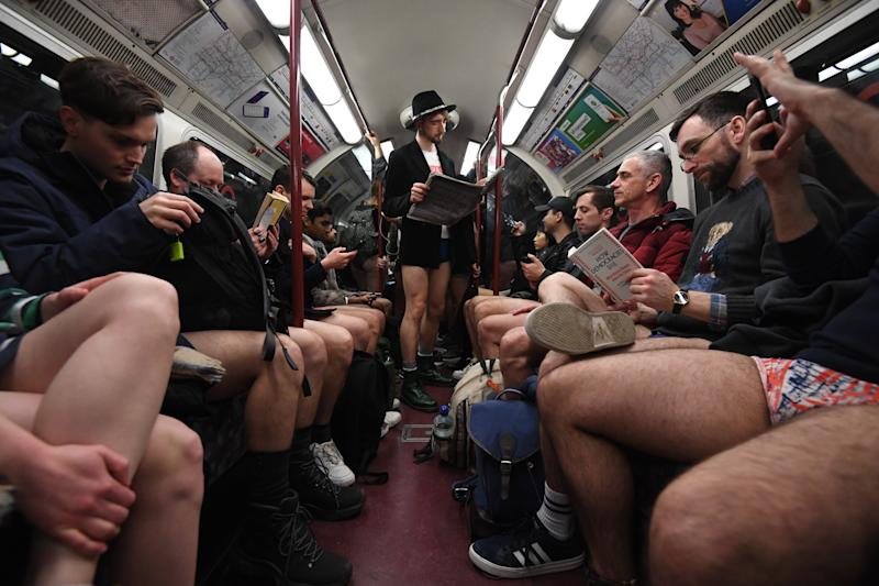 People riding the tube as they take part in the 11th annual No Trousers Tube Ride in London.
