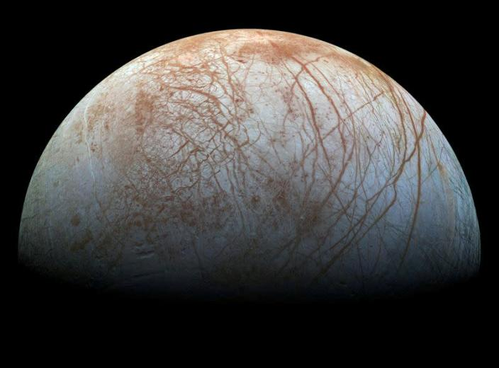 FILE PHOTO: Handout photo of a view of Jupiter's moon Europa, created from images taken by NASA's Galileo spacecraft in the late 1990's