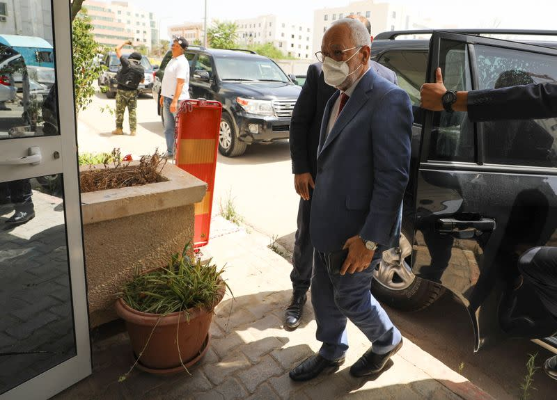 Parliament Speaker Rached Ghannouchi, head of the moderate Islamist Ennahda, arrives at the party's headquarters in Tunis