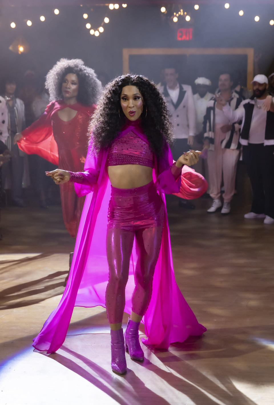 """This image released by FX shows Billy Porter as Pray Tell, background left, and Mj Rodriguez as Blanca in a scene from """"Pose."""" Rodriguez was nominated for an Emmy Award for outstanding leading actress in a drama series. (Eric Liebowitz/FX via AP)"""