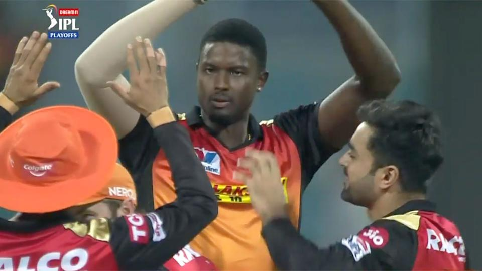 Jason Holder is seen here celebrating a wicket with Hyderabad teammates.