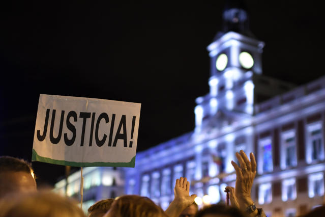 "<p>A woman holds a placard reading ""Justice"" during a demonstration to mark the International Day for the Elimination of Violence Against Women on Nov. 25, 2017, at the Puerta del Sol square in Madrid. (Photo: Gabriel Bouys/AFP/Getty Images) </p>"