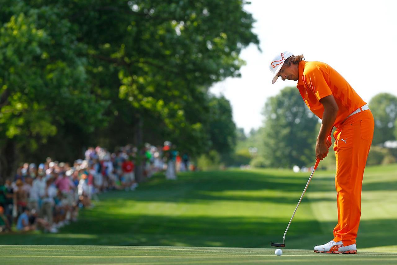 CHARLOTTE, NC - MAY 06:  Rickie Fowler of the United States putts on the 16th hole during the final round of the Wells Fargo Championship at the Quail Hollow Club on May 6, 2012 in Charlotte, North Carolina.  (Photo by Mike Ehrmann/Getty Images)