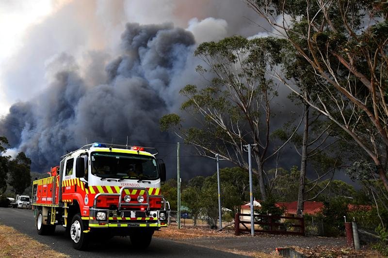 Rural Fire Service crews engage in property protection of a number of homes along the Old Hume Highway near the town of Tahmoor as the Green Wattle Creek Fire threatens a number of communities.