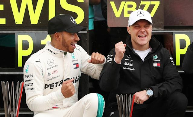 Formula One F1 - Spanish Grand Prix - Circuit de Barcelona-Catalunya, Barcelona, Spain - May 13, 2018 Mercedes' Lewis Hamilton and Valtteri Bottas celebrate after finishing first and second respectively REUTERS/Albert Gea
